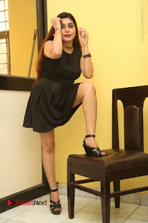 Tollywood Upcoming Actress Pooja Roshan Stills in Black Short Dress at Plus 1 Movie Trailer Launch  0198.JPG