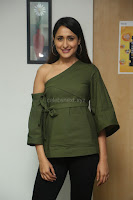 Pragya Jaiswal in a single Sleeves Off Shoulder Green Top Black Leggings promoting JJN Movie at Radio City 10.08.2017 059.JPG