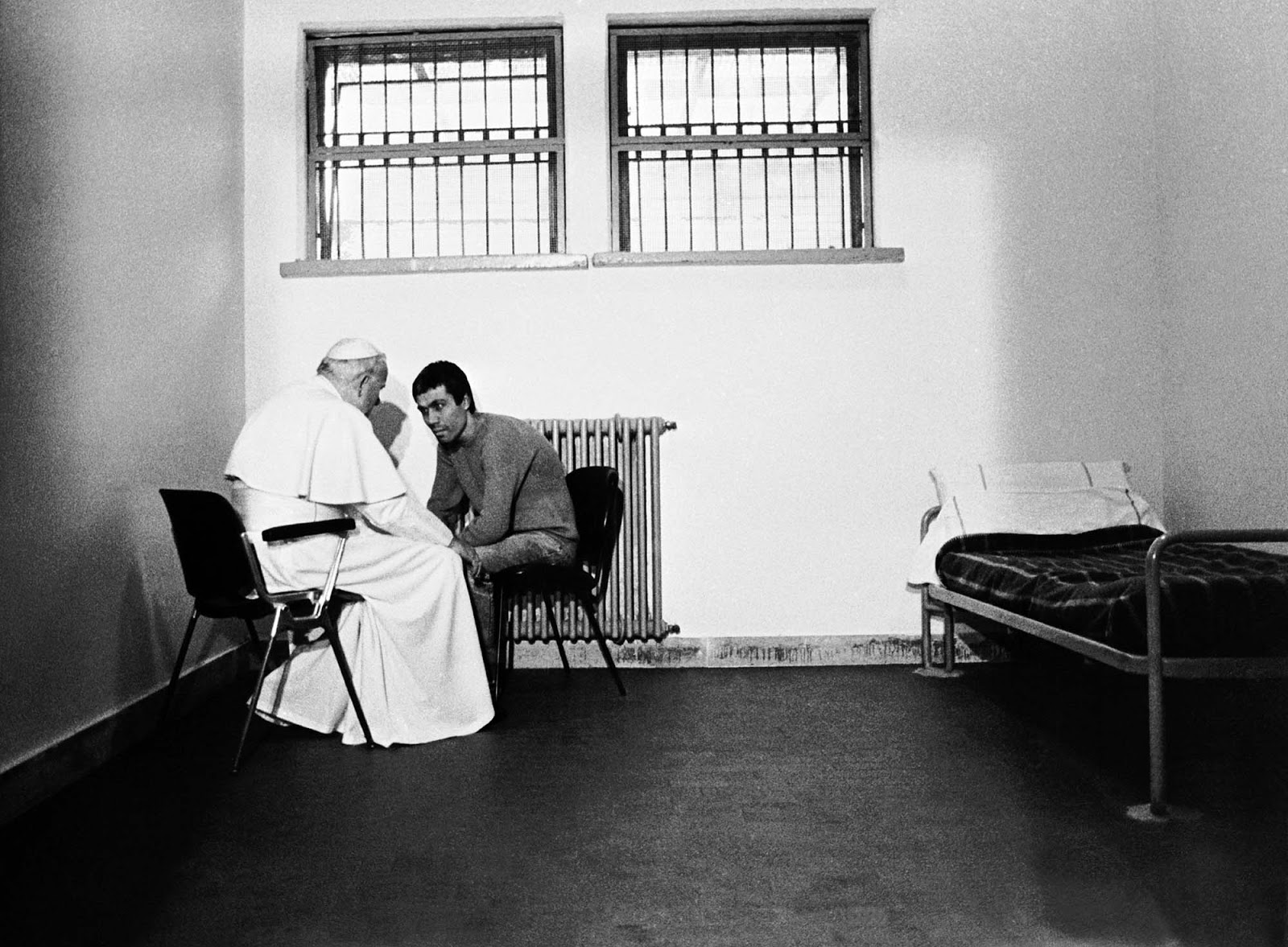 Pope John Paul II visits his would-be assassin Mehmet Ali Ağca in prison.