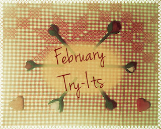 Roses in circle, stems facing faded out center.  Hearts in bottom corners.  All on red gingram fabric with cras stich design.  Image faded with yellow tone to look old.  Words read: February Try-Its