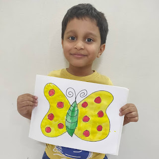 MY CHILD WITH HIS DRAWING DONE WITH FABER CASTELL PAINTS