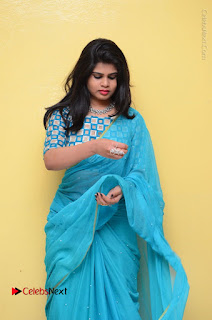 Telugu Actress Alekhya Stills in Green Saree at Swachh Hyderabad Cricket Press Meet  0040.JPG