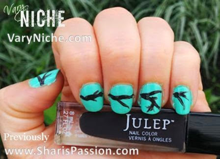 Fingernail art design step 2: Dark Brown branches painted across nails with a teal background.