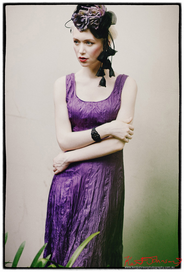 Model portrait, for fashion campaign, purple silk dress, on location. Photographed by Kent Johnson, Sydney, Australia.