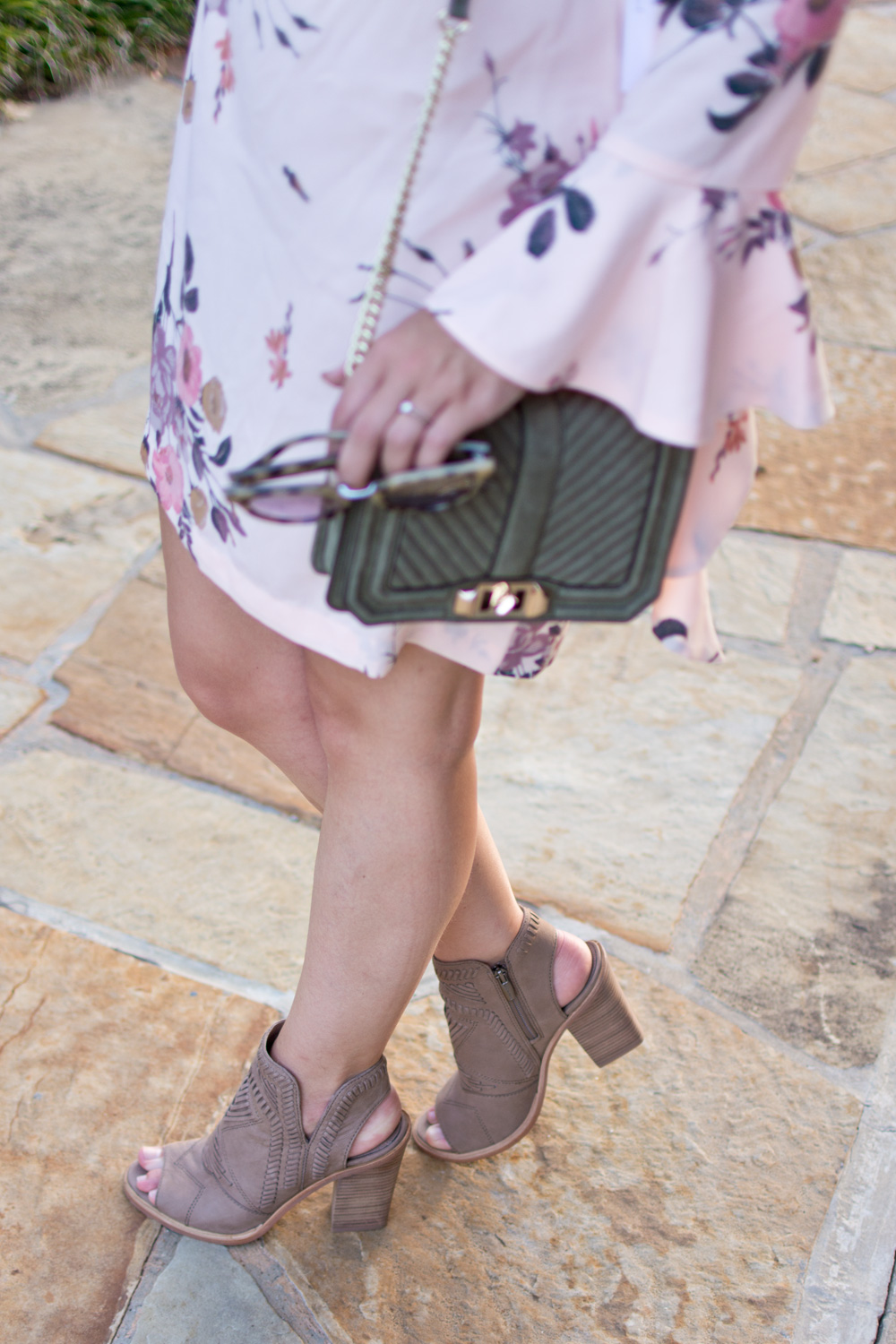 Vince Camuto booties styled with a green rebecca Minkoff bag and pink floral dress from the nordstrom anniversary sale