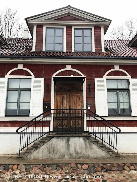 Kipsala - red wooden house. Facade Riga. Latvia.