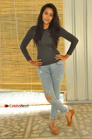 Actress Bhanu Tripathri Pos in Ripped Jeans at Iddari Madhya 18 Movie Pressmeet  0024.JPG