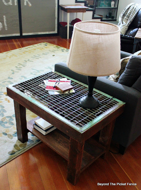 a side table made with reclaimed wood and an old grate