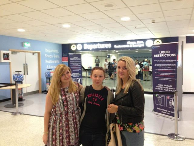 Just before heading through airport security to board our plane to Kavos