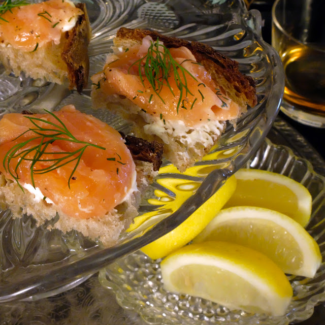 A platter of whisky-doused salmon appetizers