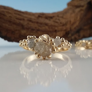 14k gold leaf wedding set with leaves and three Rough diamonds.