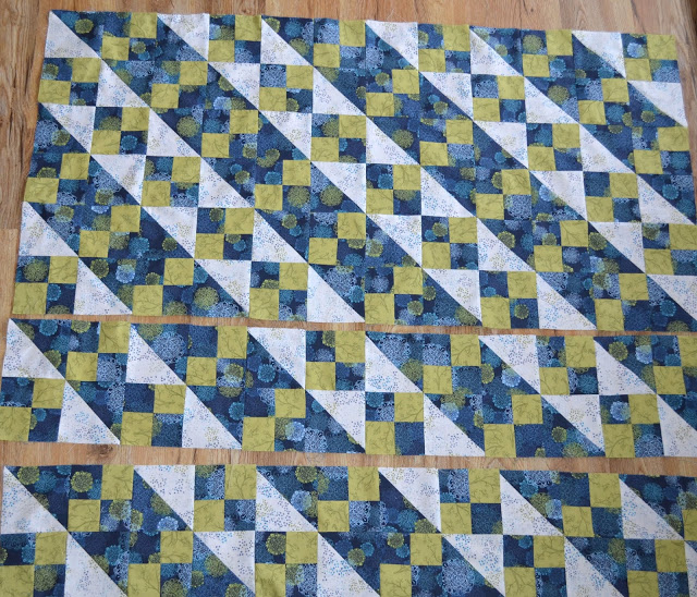 Learn how to make a versatile, scrappy lap quilt. Tutorial by Runnstitch.