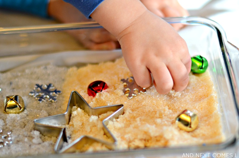 Playing with gold & silver epsom salts in a Christmas sensory bin from And Next Comes L