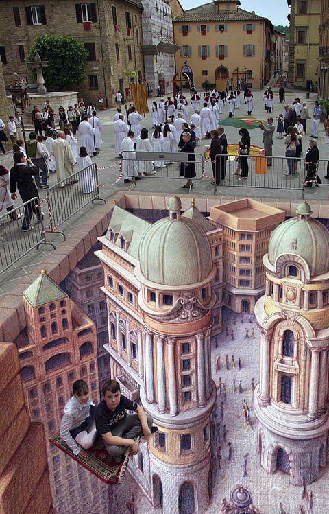 Sütunlu kuleler ve binalardan oluşan bir yer altı şehri meydanı gösteren kaldırım sanatı resmi