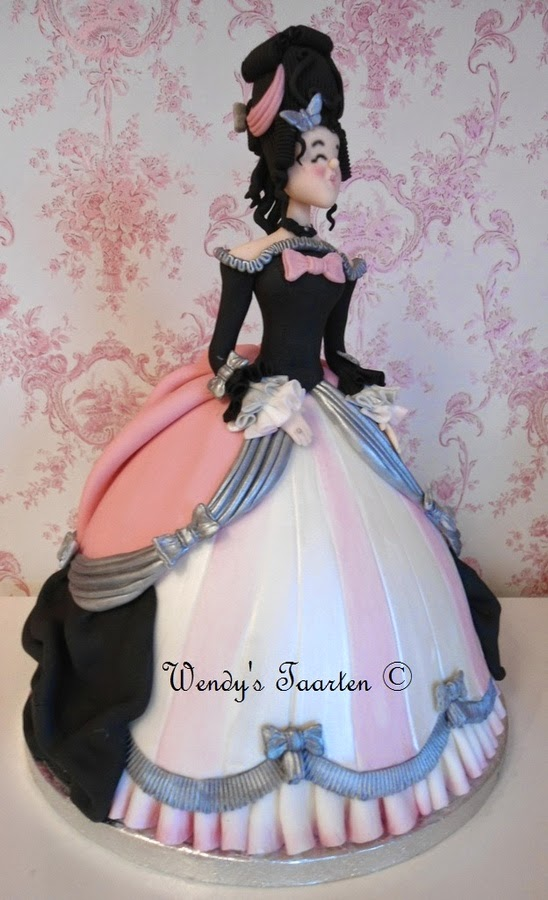 http://cakecentral.com/g/i/2146697/i-posted-my-marie-antoinette-dress-cake-yesterday-and-thougt-i-woud-post-her-ugly-step-sister-aswel-she-is-made-in-the-colors-in-witsh-my-cake-business-is-decorated/