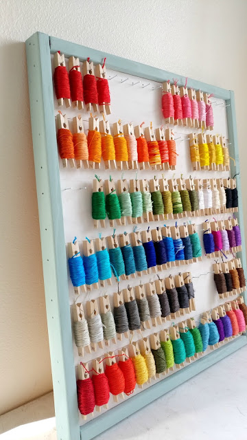organize embroidery floss with clothespins