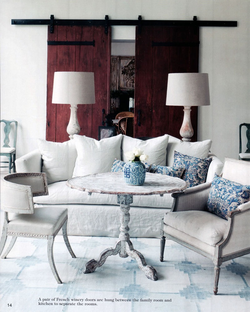 Pamela Pierce designed living room with sliding antique barn style doors and linen upholstered furniture.