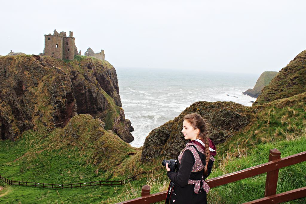 Girl with Camera beside Dunnottar Castle in Stonehaven