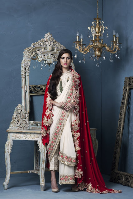 Chiffon pre draped saree with embroidered border in contrast threadwork by Designer Rashi Kapoor