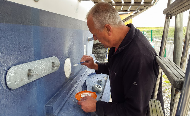 Photo of Phil applying gelcoat to the holes