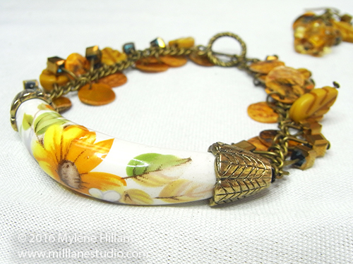 Sunflower bracelet with pre-strung yellow, beaded chain.