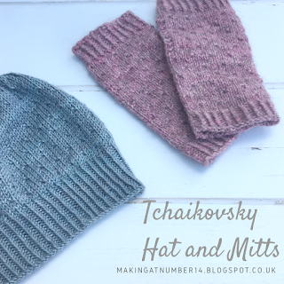 Tchaikovsky hat and mitt samples in silver and pastel pink yarn