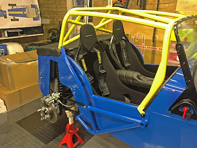 Roll cage, colour matched side intrusion bar and suspension fitted