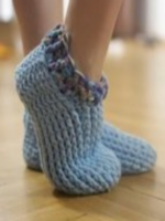 https://www.lovecrochet.com/adult-chunky-slippers-crochet-pattern-by-crochet-by-jennifer
