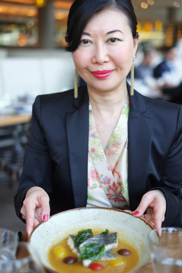 Guest Vivienne Shui with her dish of Steamed Mulloway With Spicy Lucariello Tomato. Photographed by Kent Johnson.