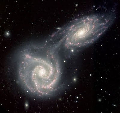 Hubble photograph of two galaxies colliding