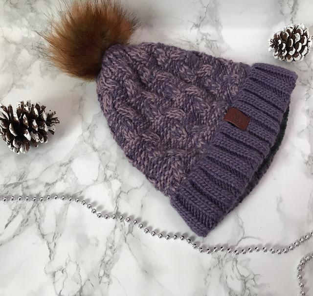 purple woollen pom pom hat