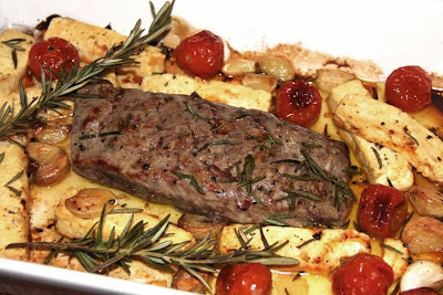 Lamb Roasted with Rosemary, Feta, Tomatoes and Garlic