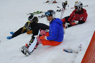 skiers sitting on slope photo