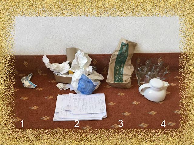 (1) winziges Plastikstück (2) viel Papier (3) Biomüll in der Papiertüte (4) Geschirr