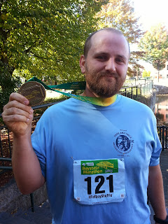 Lance with finisher medal after his first marathon.