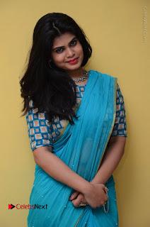 Telugu Actress Alekhya Stills in Green Saree at Swachh Hyderabad Cricket Press Meet  0052.JPG