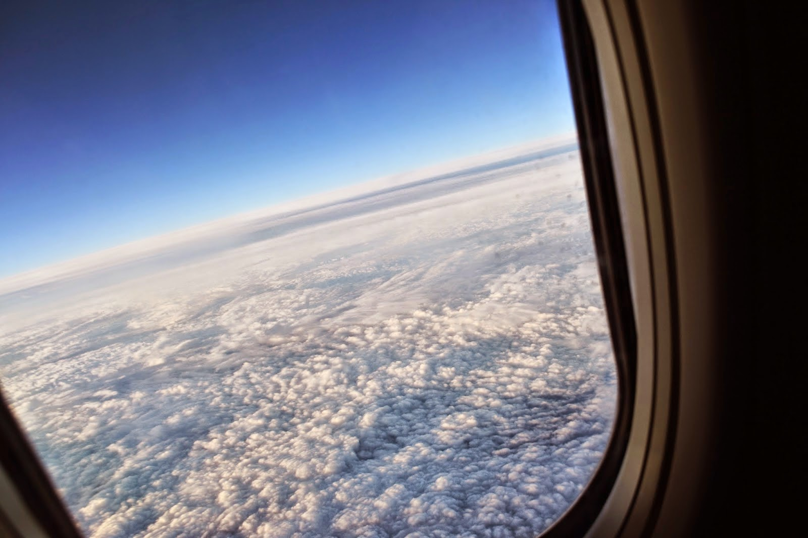 Looking out my airplane window at the clouds below on my way to turkey