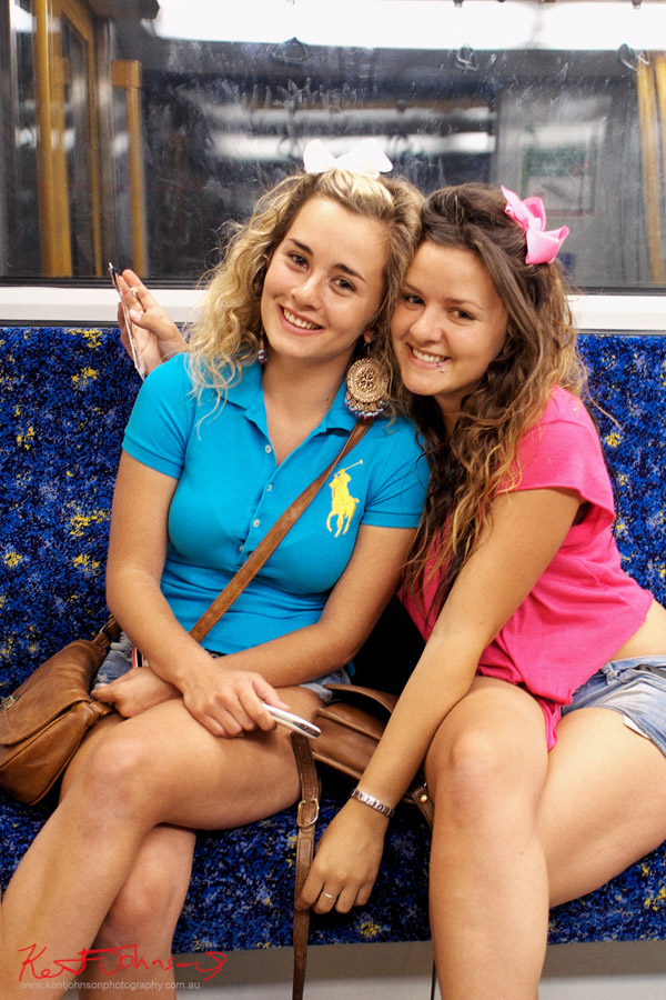 twins on the train weariing Blue polo shirt, Pink top, blue cut-off denim shorts, Street Fashion Sydney - On the train to Redfern.