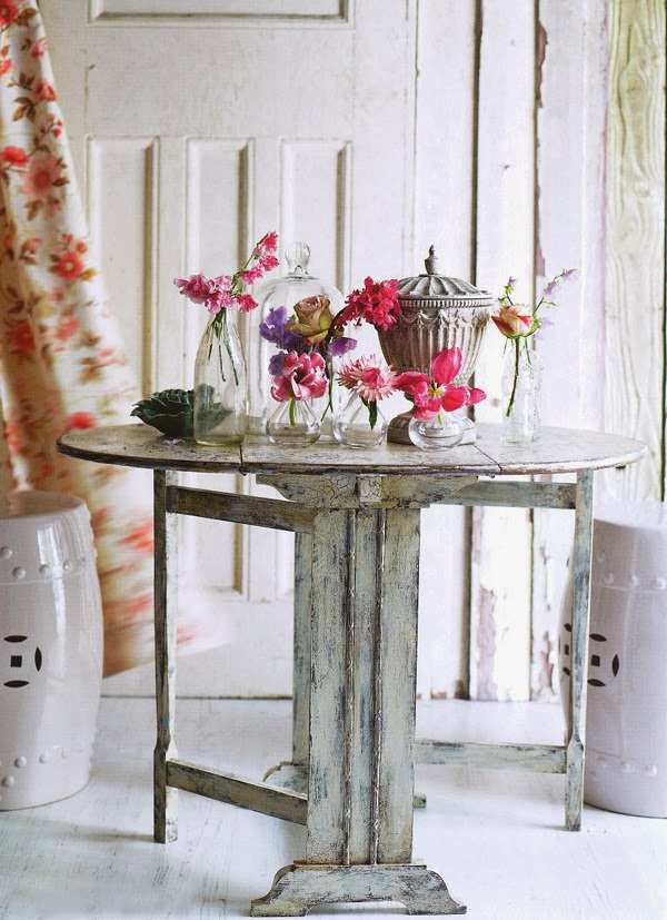 Flower arranging and pretty vintage glass bottles and vases