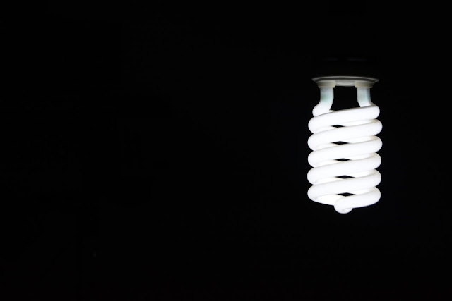 Spiral Shape Light Bulb Hang in Darkness HD Wallpaper