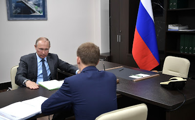Vladimir Putin at the meeting with Alexander Kozlov.