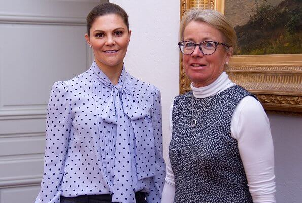 Crown Princess Victoria wore a blue polka dot bow silk blouse. Birgitta Resvik, member of IVA's Electrical Engineering Division
