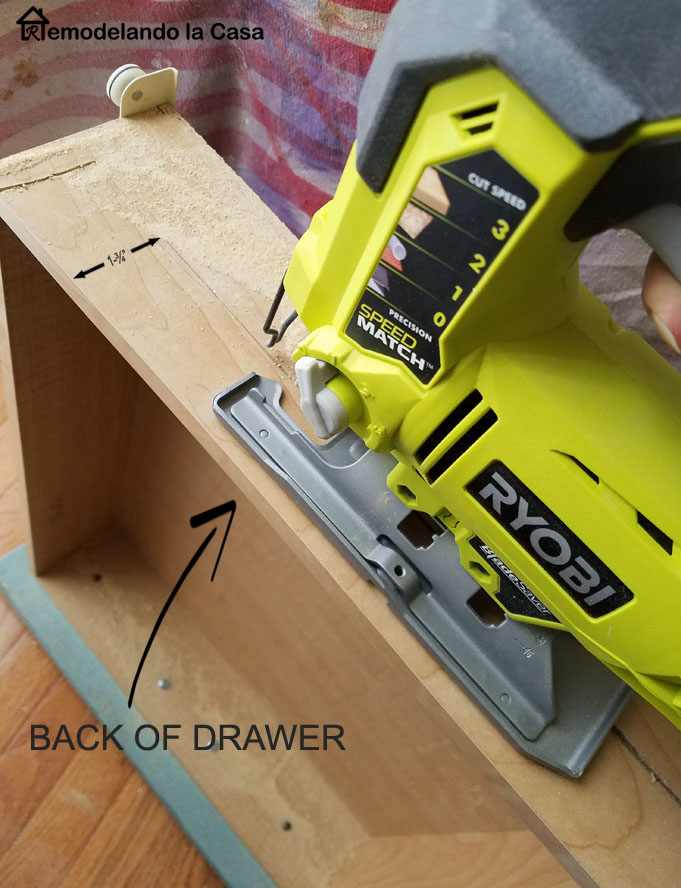 How to remove the back of a drawer to install a smaller drawer inside it. Jigsaw used to cut the back of drawer