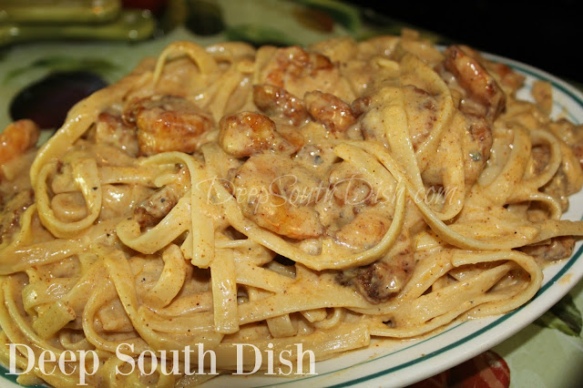 Shrimp Fettuccine Alfredo - highly spiced, sauteed shrimp, tossed in fettuccine noodles and a lighter alfredo sauce, made with 2 percent milk and a quality freshly grated Parmigiano-Reggiano.