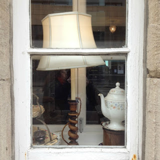 window with table lamp and teapot