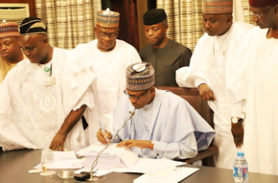 President Buhari Signs 2018 Budget