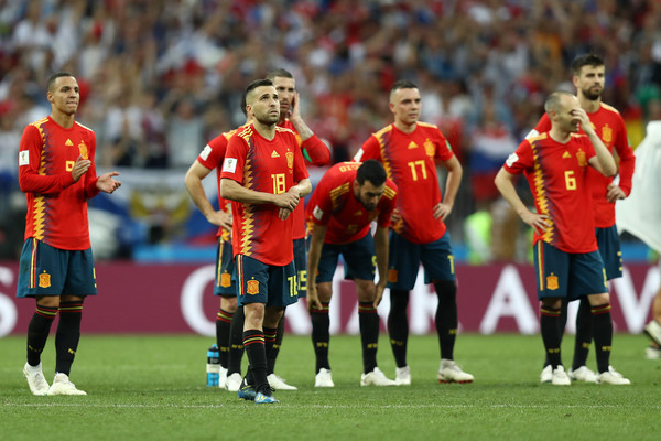 Spain team react following team mate Koke (not pictured) missing his side's third penalty, in the penalty shoot out during the 2018 FIFA World Cup Russia Round of 16 match between Spain and Russia at Luzhniki Stadium on July 1, 2018 in Moscow, Russia.