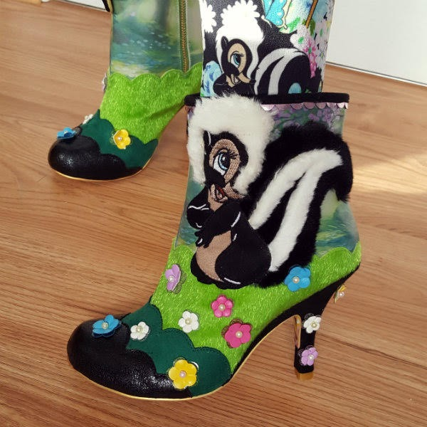close up of Disney Bambi ankle boot with skunk fluffy applique