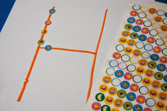 place stickers on letter as learning activity