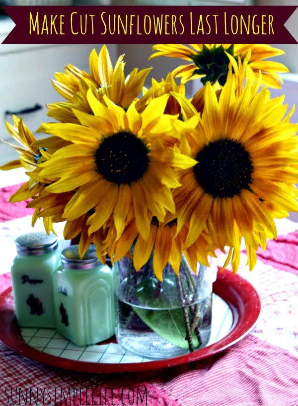 sunflowers in vase, vintage tray, jadeite salt and pepper